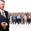 Smiling business man with colleagues in the background — Stock Photo