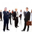 Stock Photo: Business team formed of young businessmen standing over white background
