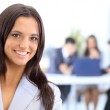 Face of beautiful woman on the background of business — Stock Photo #6203782
