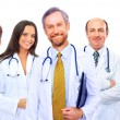 Portrait of group of smiling hospital colleagues standing together — Stockfoto