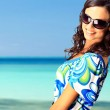 Bright picture of lovely brunette woman at the sea — Stock Photo