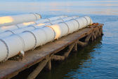 A closeup of large sewage pipes — Stock Photo