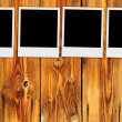 Four Blank Photos on Wooden Wall — Stock Photo #5550560