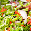 Green Tomato, Pepper and Onion Salad on Wooden Spoon — Stock Photo #6295754