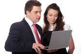 Casual couple looking at laptop — Stock Photo
