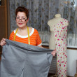 Stock Photo: Old womsews clothes in-home