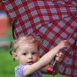 Stock Photo: Little girl with a umbrella in park