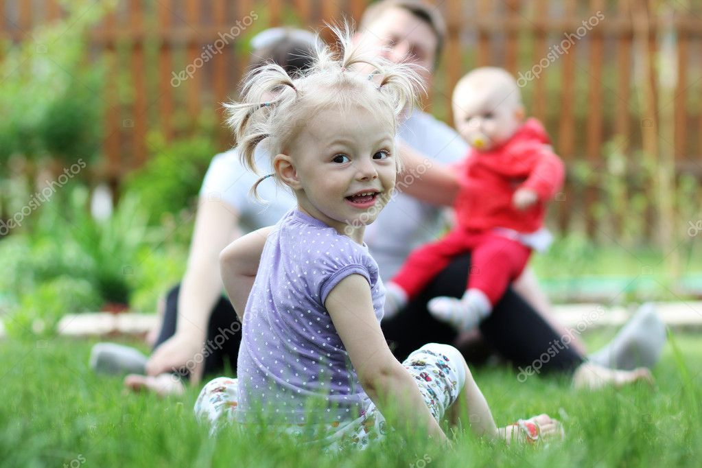 Family of four enjoying outdoors  — Stock Photo #5731740