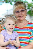 Grootmoeder met baby — Stockfoto