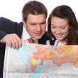 Casual couple with map — Stock Photo