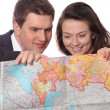 Casual couple with map — Stock Photo #6167446