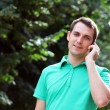 Young attractive man calling by phone — Stock Photo #6462205