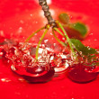 Cherries tumbling — Stock Photo