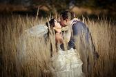 Couple in autumn field — Stock Photo