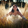 Bride in autumn field — Stock Photo