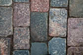 Cobblestone road fragment — Stock Photo
