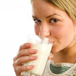 Pretty girl drinking milk — Stock Photo #6724355