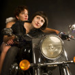 Faraway look biker girl with guardian angel — Stock Photo
