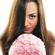 Beautiful girl with a bouquet of carnations — Stock Photo #6726914