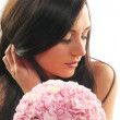 Beautiful girl with a bouquet of carnations — Stock Photo