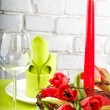 Composition with tulips, candle and glass — Stock Photo