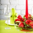 Composition with tulips, candle and glass - Foto Stock