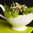 Gravy boat flower decorated - Stock Photo