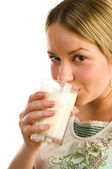 Pretty girl drinking milk — Stock Photo