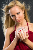 Glamor model with chrystal ball — Stock Photo