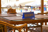 Reserved sign on the table — Stock Photo