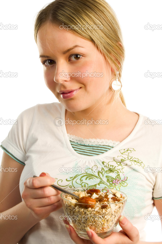 Pretty woman holding a spon with cereal   — Stock Photo #6724409