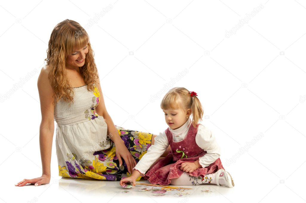 Mother helping her daughter with puzzle  Stock Photo #6726135