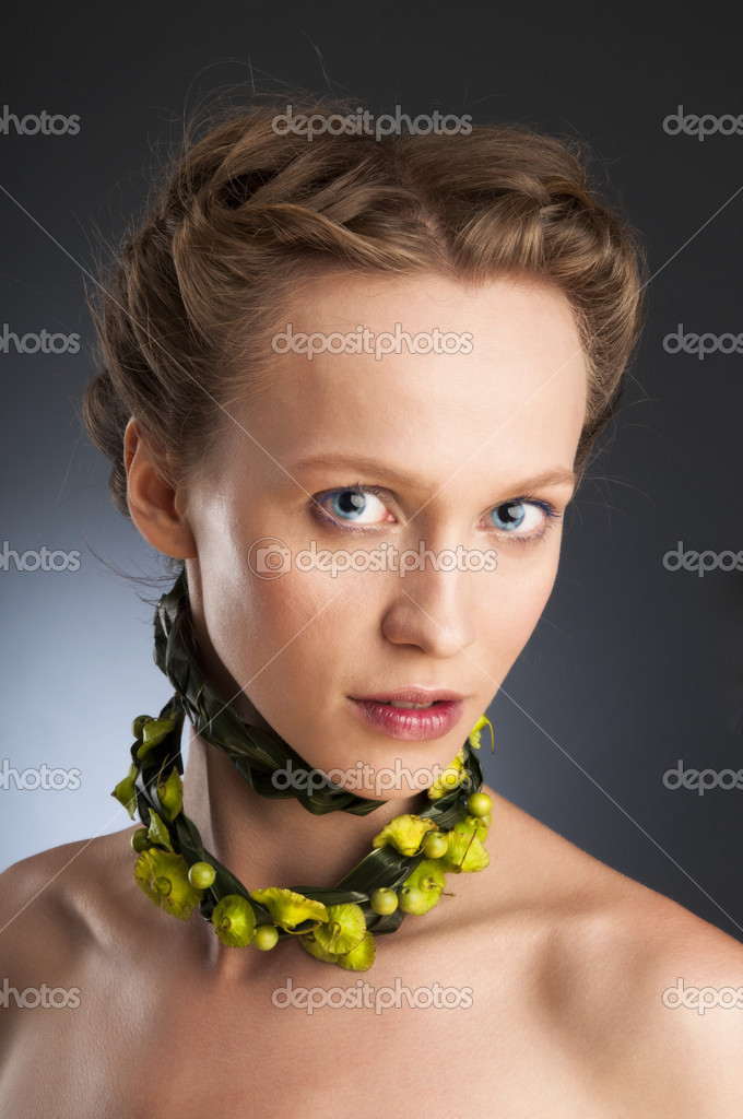 Attractive girl portrait with floristic necklace.Concept of natural beauty.   Stock Photo #6726392