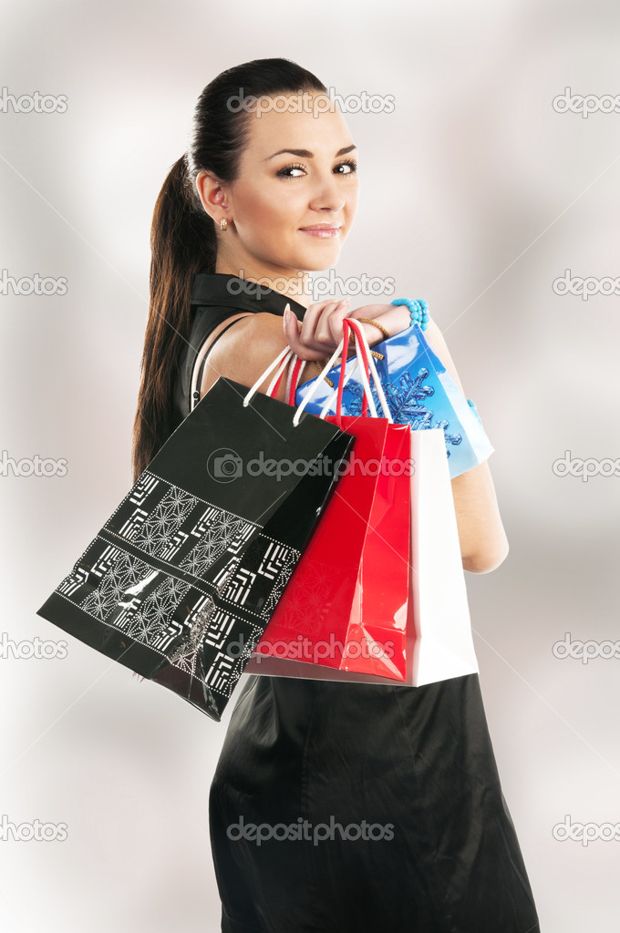 Beautiful girl with shopping bags  Stock Photo #6726897