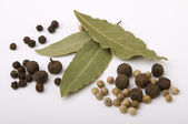 Pepper and bay leaves — Stock Photo