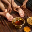 Traditional indian ayurvedic oil foot massage - Stock Photo