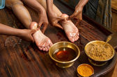 Traditional indian ayurvedic oil foot massage — Stock Photo