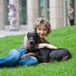 The young woman with a dog on a grass — Stockfoto