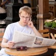 Morning coffee and newspaper — Stock Photo