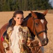 The woman in clothes of 18 centuries with horse — Stock Photo #6413274