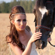The woman in clothes of 18 centuries with horse — Stock Photo