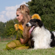 Stock Photo: The woman in a beautiful old style dress with borzoi dogs