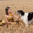 The young woman with borzoi — Stockfoto