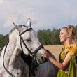 Horse and woman face to face — Stock Photo #6433664