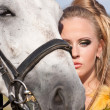 Horse and woman face to face - Stock Photo