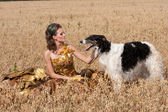 The young woman with borzoi — Stock Photo