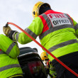 Fireman with Power Wedge at car crash - Photo