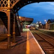Railway Station and Old bridge  at night - Stock Photo