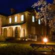Stock Photo: Old Railway Hotel at night and cherry blossom