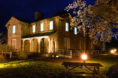 Old Railway Hotel at night and cherry blossom — Stock Photo